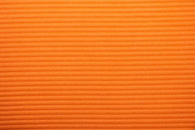 Natural texture of bright orange fabric