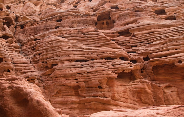 Natural texture of red rocks close up