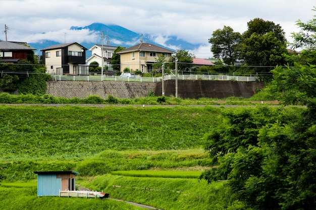 Natural town houses and mountains in the city nagano, japan.