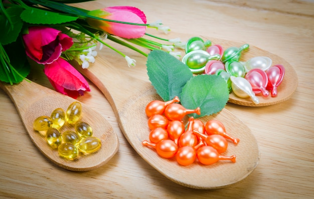 Natural vitamins for good health in a wooden spoon