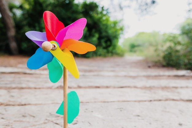 Natural wall with the colorful image of a toy pinwheel representing a prosperous future.