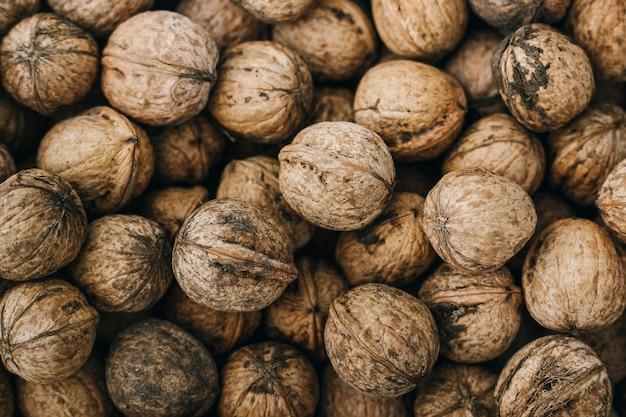 Natural walnut texture, raw bio walnuts background