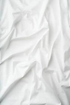 デザインのための自然な白い布のリネンの質感。背景またはモックアップ用の白いキャンバス。