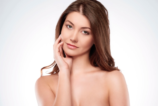 Natural woman takes care about condition of skin
