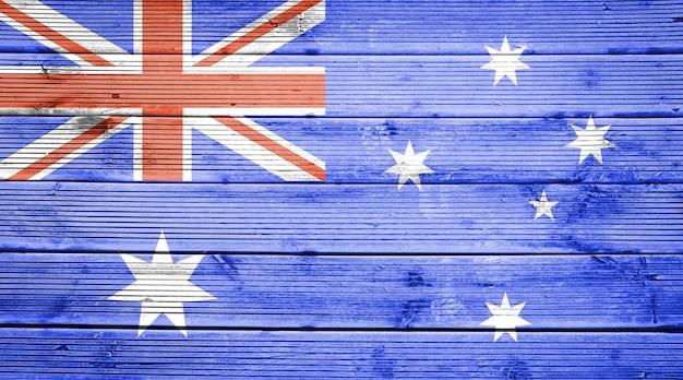 オーストラリアの旗の色と天然木の板のテクスチャ背景