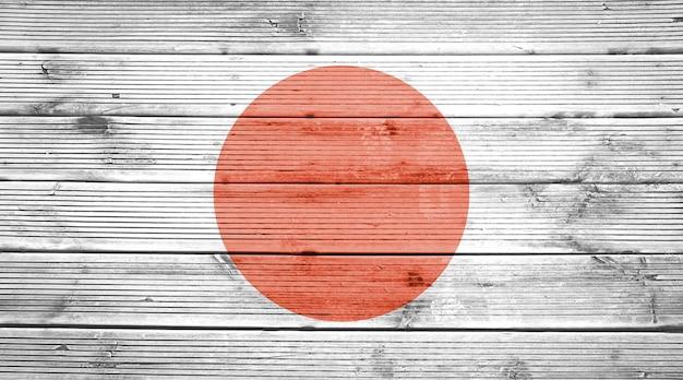 日本の国旗の色と天然木の板のテクスチャ背景