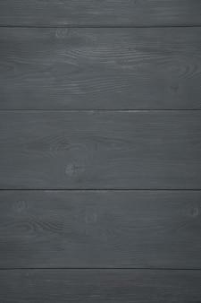 自然な木製の背景を黒で塗装。縦ビュー。木の質感。