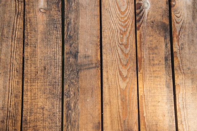 茶色の表面の抽象的なテクスチャと自然な木製の背景。
