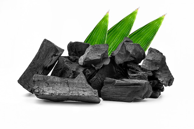 Natural wooden charcoal or traditional hard wood charcoal isolated on white background.