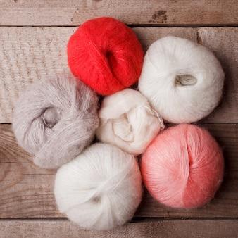 Natural woolen yarn rustic wooden background.