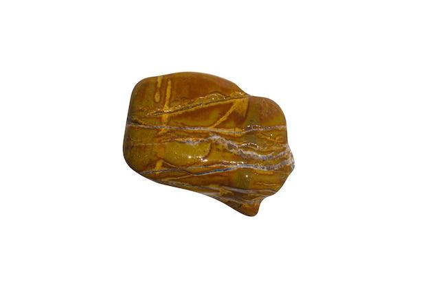 白い背景で隔離の自然な黄色の石。高品質の写真