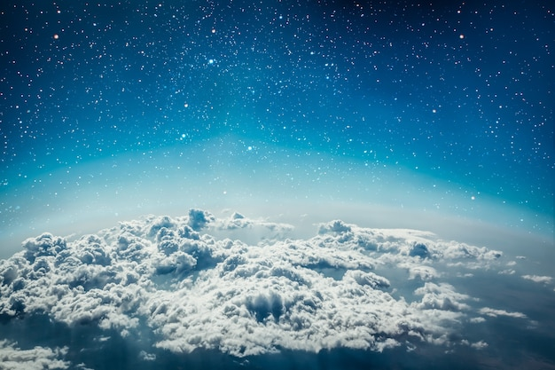 Nature background white clouds over blue star sky