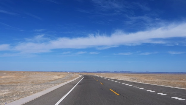 Nature landscape view of high way road under sunny blue sky in dunhuang gansu china