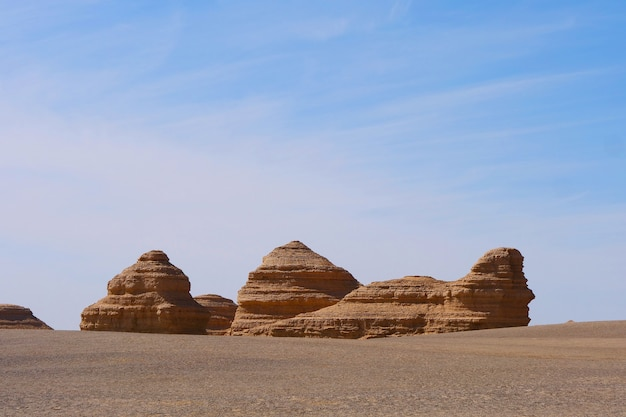 Nature landscape view of yardang landform under sunny blue sky in dunhuang unesco global geopark