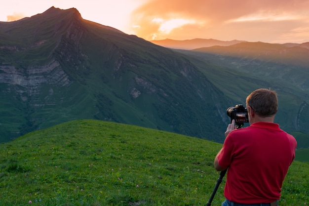 Nature photographer take shot in mountains