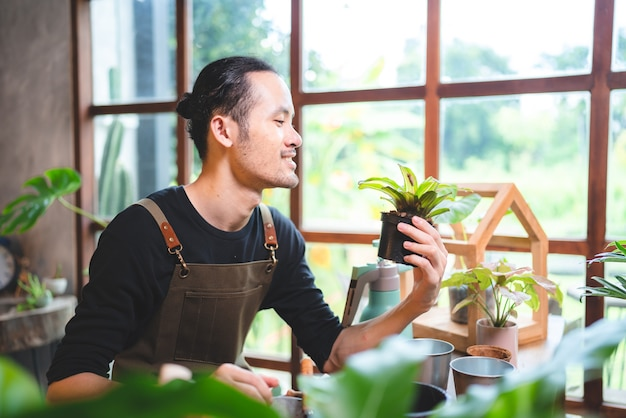 Nature plant gardening hobby, happy man person lifestyle with growing flower green leaf and agriculture work in summer, environment concept at home in hobby