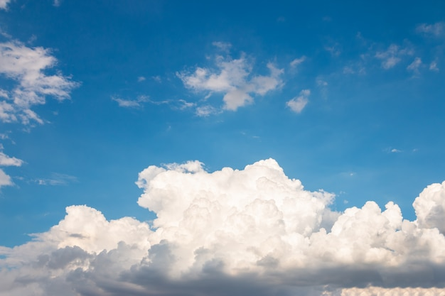 Nature skyscape, large white clouds in the blue sky