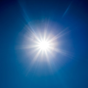 Nature surface. white sun over blue sky