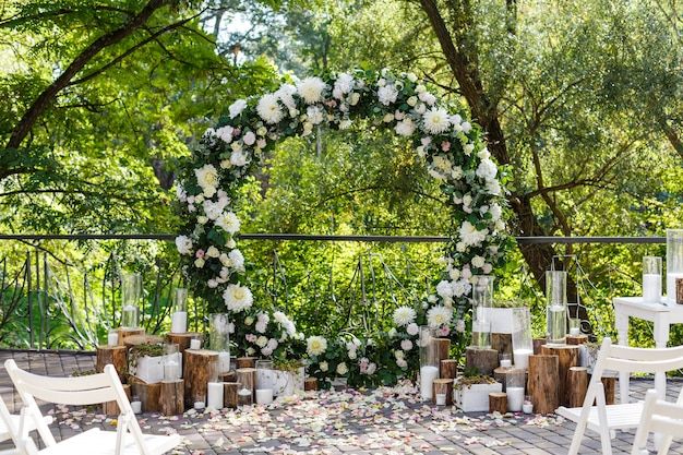 Nature theme in wedding ceremony decoration newlyweds arch decorated in rustic style