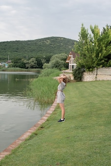 Nature and travel concept. woman standing near the lake