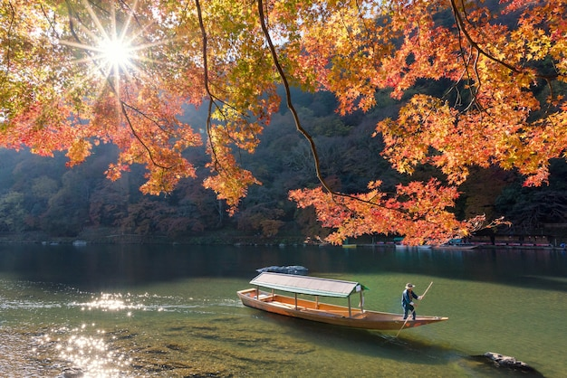 Nature view of arashiyama in autumn season along the river in kyoto, japan.