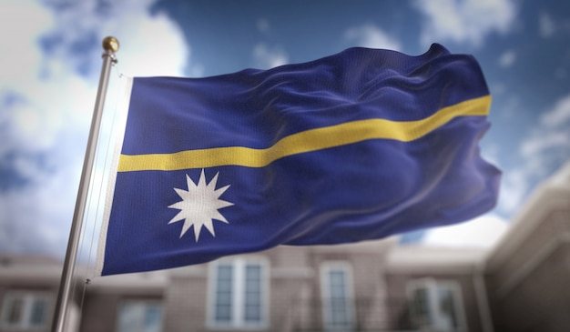 Nauru flag 3d rendering on blue sky building background
