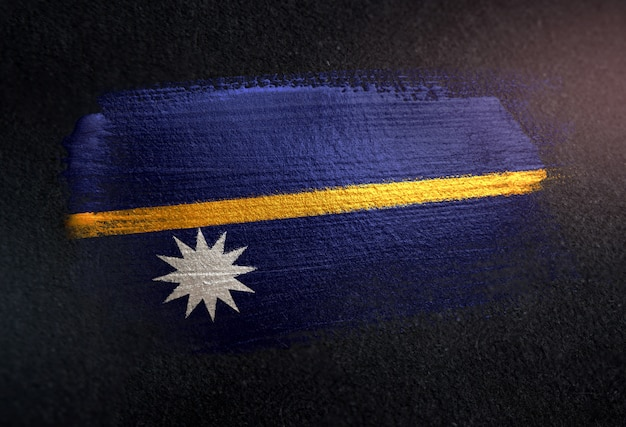 Nauru flag made of metallic brush paint on grunge dark wall