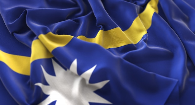 Nauru flag ruffled beautifully waving macro close-up shot