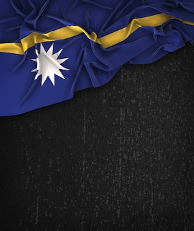 Nauru flag vintage on a grunge black chalkboard with space for text