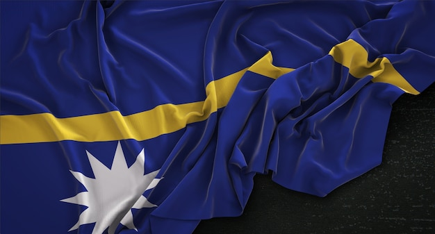 Nauru flag wrinkled on dark background 3d render