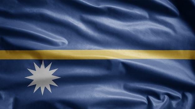 Nauruan flag waving on wind, nauru banner blowing, soft and smooth silk