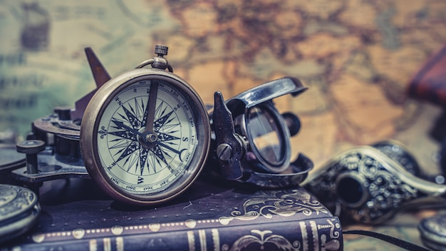 Nautical compass on book
