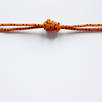 Nautical orange rope knot with shadows