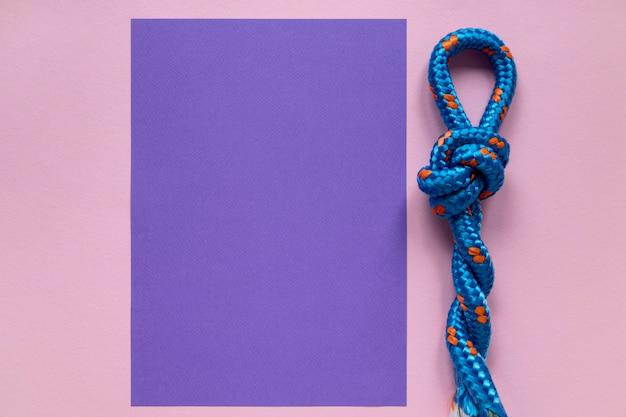 Nodi di corda nautica e carta dello spazio della copia