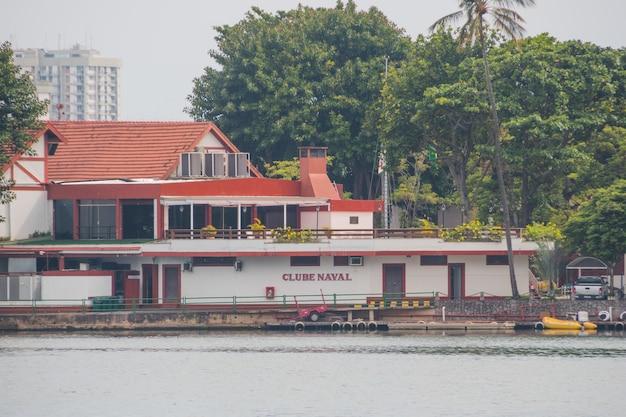 Naval club at lagoa rodrigo de freitas in rio de janeiro, brazil - february 13, 2021: view of the naval club at lagoa rodrigo de freitas in rio de janeiro.