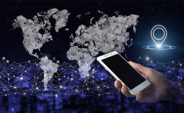 Navigation, map and innovation. hand hold white smartphone with digital hologram world, earth, map, location marker sign on city dark blurred background. gps map, pin address location on mobile apps.