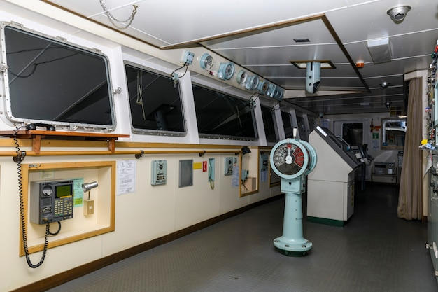 Navigational bridge on big cargo ship. wheelhouse on vessel.