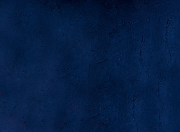 Navy abstract decorative dark blue stucco wall fund. textured background