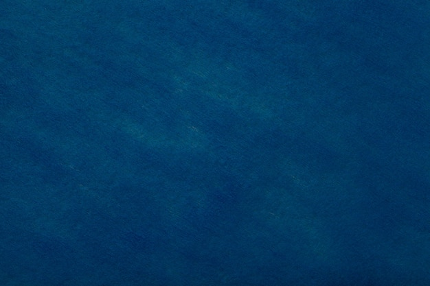Navy blue background of felt fabric