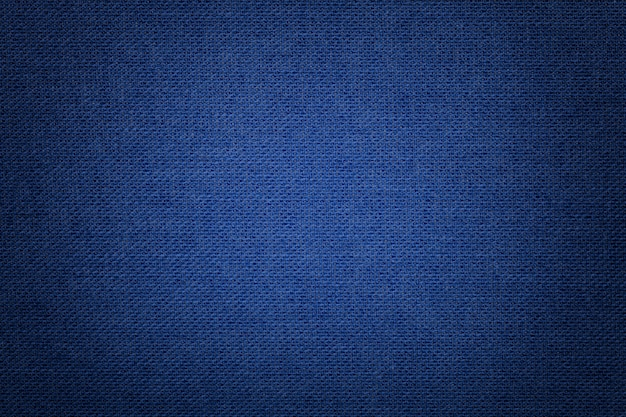 Темно-синий фон из текстильного материала с плетеной узором, крупным планом.