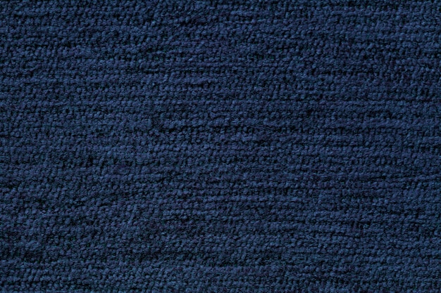 Navy blue background from soft textile material. fabric with natural texture.