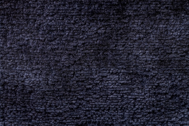 Navy blue background from soft textile material  fabric with natural texture