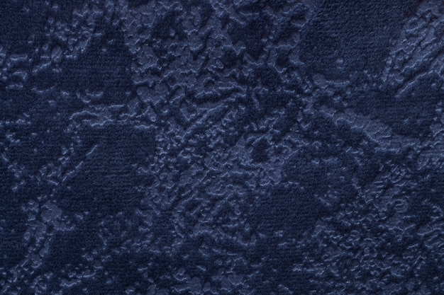 Navy blue background from a soft upholstery textile material, closeup.