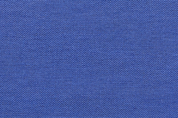 Navy blue background from a textile material with wicker pattern, closeup.