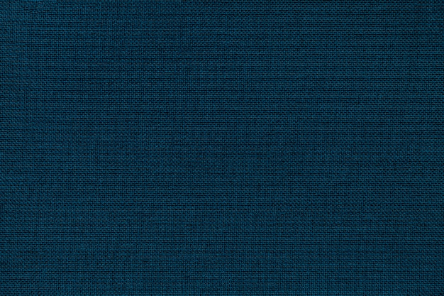 Navy blue background from a textile material with wicker pattern