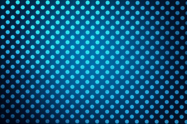 ターコイズブルーの水玉のクローズアップのパターンで包装紙からネイビーブルーの背景。