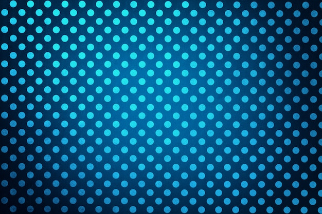 Navy blue background from wrapping paper with a pattern of turquoise polka dot closeup.