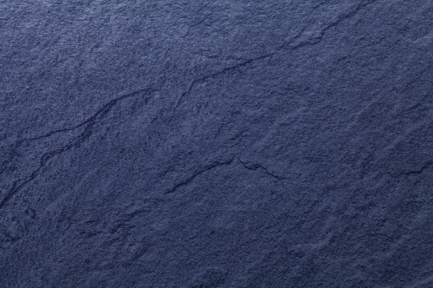 Navy blue background of natural slate. texture of stone closeup.