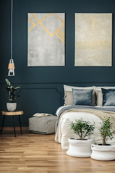 Navy blue bedroom with art