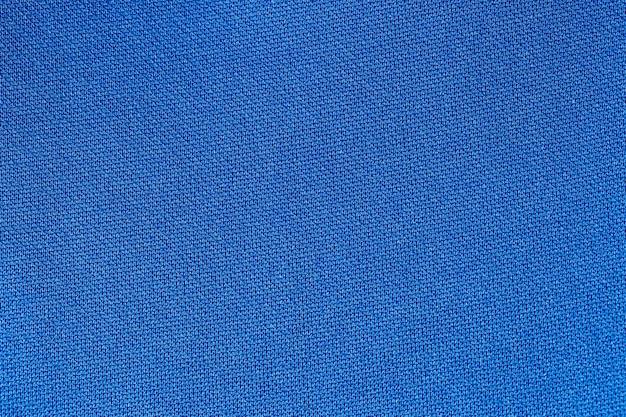 Предпосылка текстуры полиэстера ткани темно-синего цвета.